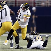 Steelers quarterback Ben Roethlisberger is injured as he is hit by St. Louis Rams strong safety Mark Barron during the third quarter Sunday in St. Louis.