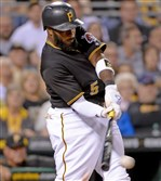 Pirates' Josh Harrison gets a hit against the Cardinals in the third inning Monday at PNC Park.