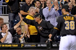 Pirates fans celebrate after Joakim Soria struck out Cardinals' Jhonny Peralta in the seventh inning Monday at PNC Park.