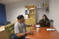 Irwin Scott, who served as a Marine during the Vietnam era, speaks with Kayla Berkey in Larimer. Mr. Scott was signing up for expanded Medicaid programs in the state and is hoping to get dental coverage.