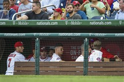 Washington Nationals' Bryce Harper and Jonathan Papelbon fight in the dugout in the eighth inning of a baseball game against the Philadelphia Phillies, Sunday, Sept. 27, 2015, in Washington.