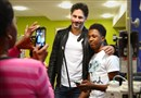 Actor Joe Manganiello visits with Daejor Slappy of Midland while Daejor's mother Shawndelle Wise takes a photo last year at Children's Hospital of Pittsburgh of UPMC in Lawrenceville. Mr. Manganiello has been named a member of the board for the Children's Hospital of Pittsburgh Foundation.