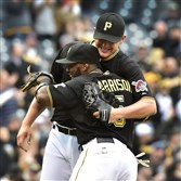 Pirates reliever Jared Hughes celebrates with Josh Harrison after beating the Cardinals 8-2 Wednesday afternoon at PNC Park.