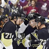 The Penguins' Sergei Plotnikov (center) celebrates a first-period goal against the Tampa Bay Lightning Tuesday night in a preseason game at the Cambria County War Memorial in Johnstown, Pa.