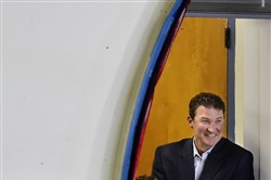 Penguins owner Mario Lemieux takes in a September exhibition game at the Cambria County War Memorial Arena in Johnstown. He and co-owner Ron Burkle announced in June they were exploring a sale of the franchise.