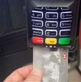 A debit card is seen in a chip and pin machine on May 21, 2015 in Bristol, England. Cashless payments have overtaken the use of use notes and coins for the first time according to the Payments Council.