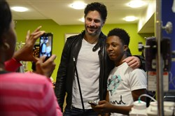Actor Joe Manganiello visits with Daejor Slappy, 16, of Midland while Slappy's mother Shawndelle Wise takes a photo Wednesday at Children's Hospital in Lawrenceville. Mr. Manganiello is the chair of the hospital's gala, happening later this week.