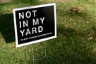 "A sign that reads ""Not in My Yard *No Bows & Arrows * No Hunting * No Way"" sits in a yard near the intersection of Twin Hills Drive and Meadowcroft Avenue in Mt. Lebanon."