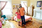 Kate and Nik Stoltzfus, shown in July 2014, are among the hundreds of Pittsburghers who use Airbnb to rent out rooms, apartments or homes. They rent out a mother-in-law apartment in Garfield and screen potential guests carefully.