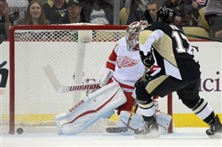 Red Wings goaltender Petr Mrazek can't stop a goal by the Penguins' Daniel Sprong in a preseason game last month at Consol Energy Center.