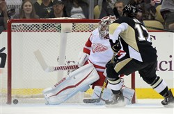 Red Wings goaltender Petr Mrazek can't stop a goal by Penguins' Daniel Sprong in the second period at Consol Energy Center.