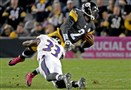 The Baltimore Ravens' Will Hill III takes down Mike Vick in overtime Thursday at Heinz Field.