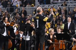 The Pittsburgh Symphony Orchestra performs during half-time at Heinz Field Thursday night as former Steeler Jerome Bettis is honored with his Hall of Fame ring.