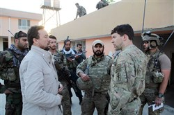 Kunduz chief of police, Mohammad Qasim Jangalbagh, left, talks to U.S. and Afghan special forces in Kunduz city, north of Kabul, Afghanistan, on Thursday.