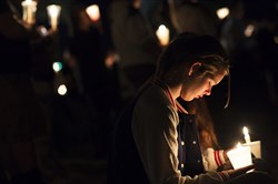Elizabeth Cox, 14, bows her head Thursday during a prayer at a vigil to honor victims of a shooting at Umpqua Community College.