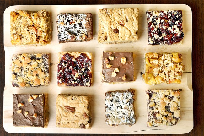 A tray of dessert bars featuring Cranberry Pear Bars, Apple Crumb Bars, Hazelnut Jam Bars, Chocolate-Coconut Bar, Chocolate-Butterscotch Crispy Bars and Jack's Favorite Blondies.