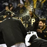 Starling Marte celebrates with teammates after his walk-off home run Friday night to beat Cincinnati.