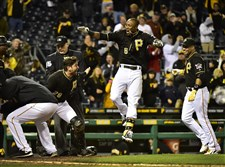 Starling Marte celebrates after hitting a walk-off home run in the 12th inning Friday night against the Reds at PNC Park.