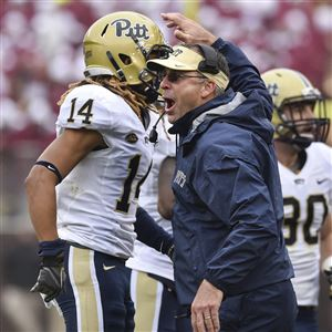 Pat Narduzzi congratulates cornerback Avonte Maddox on his interception last time Pitt traveled to Virginia Tech, in 2015. The Panthers won, 17-13, but they didn't see the real Lane Stadium effect that day.