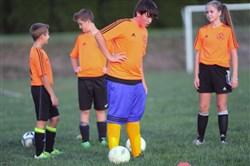 Andrew Lusebrink, center, and teammates break during drills. Providence Heights Alpha School combined soccer teams with St. Ursula in Hampton to become Allison Park United.