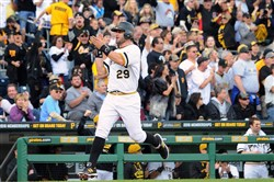 Francisco Cervelli cheers with the crowd as he heads home to put the Pirates up 3-0 against the Cincinnati Reds Sunday at PNC Park.