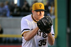Mark Melancon pitches in the ninth inning Oct. 4 against the Reds.