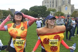 Irene Lee, left, and Maddie Mesard dance to music played at the end of last year's Donut Dash at Schenley Plaza in Oakland. Both are Kappa Alpha Theta sorority members.