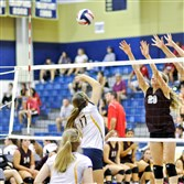 Beaver Area junior outside hitter Grace Oram (29) and sophomore middle hitter Alexa Mamone jump for a block last month.