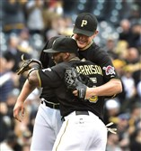 Pirates reliever Jared Hughes celebrates with Josh Harrison after beating the Cardinals 8-2 at PNC Park last September.