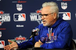 Cubs manager Joe Maddon talks to the media Tuesday at PNC Park.