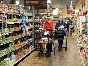 Shoppers browse the aisles in the Market District store in Waterworks Mall. A new survey of Downtown residents shows they would most like to see a full-service grocery store added to their neighborhood.