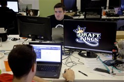 Len Don Diego, marketing manager for content at DraftKings, a daily fantasy sports company, works at the company's offices in Boston last month.