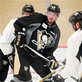 Penguins defenseman Tim Erixon, center, is one of many players trying to make a strong impression on the coaching staff this preseason.