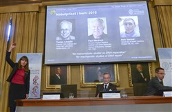 Professor Sara Snogerup Linse, left  explains why the laureates were awarded during a news conference at the Royal Swedish Academy in Stockholm, today. Sweden's Tomas Lindahl, American Paul Modrich and U.S.-Turkish scientist Aziz Sancar won the Nobel Prize in chemistry.