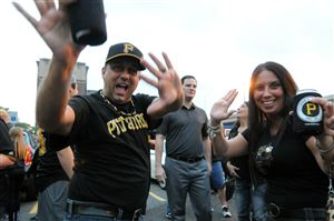 Pirates fans Anthony Febbraro, left, and his wife, Roseanna, right, of Shaler tailgate before the Pirates-Cubs wild-card game at PNC Park on Wednesday.