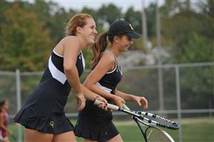 Quaker Valley's Emily Kraus, left, and Zoe Bojalad show their emotion as they go to the net to shake hands with the Vincentian doubles team after defeating it in the WPIAL AA girls' tennis championships at North Allegheny High School on Wednesday. They won 6-1, 6-2.