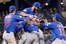 Cubs pitcher Jake Arrieta is mobbed after pitching a complete game Wednesday against the Pirates on Wednesday.