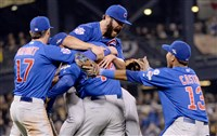 Cubs' pitcher Jake Arrieta is mobbed after defeating the Pirates during the National League Wild Card Game at PNC Park.