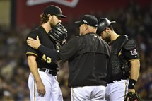 Pirates pitching coach Ray Searage and catcher Francisco Cervelli talk to pitcher Gerrit Cole on the mound during the National League wild-card game Oct. 7.