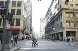 The intersection of Smithfield Street and Fifth Avenue, with the former Macy's building on the left and Oxford Development Company's property on the right. Sources say Oxford has agreed to sell the building to Cleveland-based Stark Enterprises.