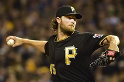 Pirates pitcher Gerrit Cole delivers a pitch against the Cubs during the NL wild-card game last October at PNC Park.