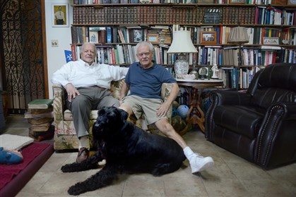"Nino Esposito, left, and Roland ""Drew"" Bosee pose for a portrait at their home on Forest Highlands Drive Oct. 8. Mr. Esposito and Mr. Bosee have been together for 45 years."