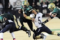 Belle Vernon's Luke Durigon tries to break a tackle by Ringgold's Jordon Briscoe Friday night. Belle Vernon won, 13-12, at home.