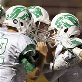 South Fayette's Hunter Hayes, center, celebrates with Drew Saxton, left, and another teammate after rushing for a touchdown in the first half Friday night against Steel Valley.