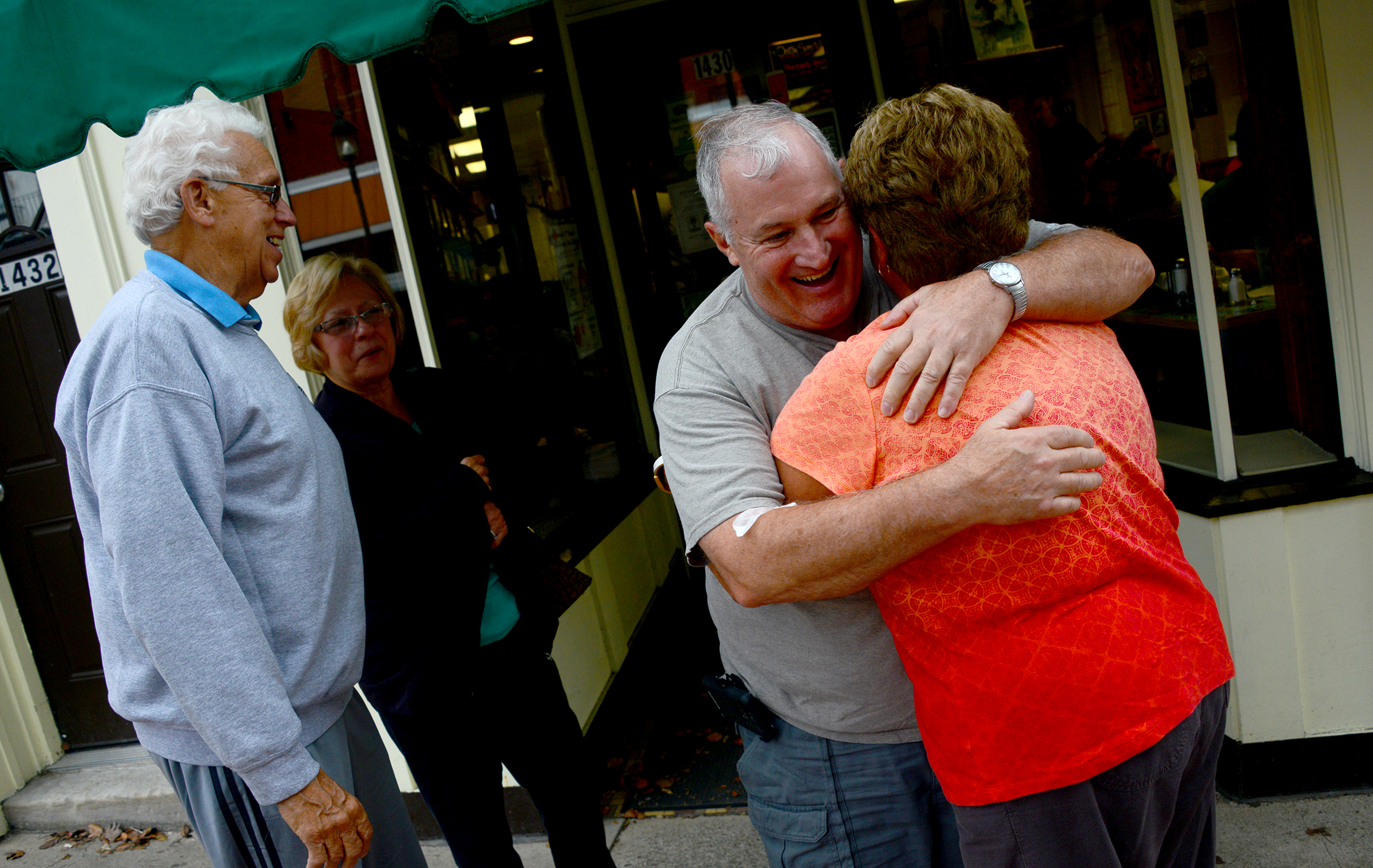 20151009lf-Restaurant01-16 Mark Duffy of Beechview gives Vicki Lawhorne a hug after having breakfast with his wife Peg at Dor-Stop Restaurant in Dormont while Bob Lawhorne looks on.