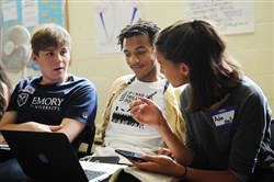 From left, CAPA High School students Aleksei Kaminski, Wesley Peters and Ada Griffin discuss racial categorizations at the workshop.