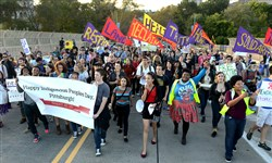 Hundreds of people march through Oakland during an Indigenous People's Day celebration on Monday, Oct. 12, 2015.  The celebration aims to place focus on the culture and history of indigenous people, rather than the legacy of Christopher Columbus.