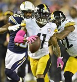 The Steelers' Antwon Blake intercepts a pass and takes it in for a touchdown against the San Diego Chargers Monday night.
