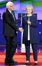 Democratic presidential candidates Bernie Sanders and Hillary Clinton shake hands during a debate in Las Vegas in October.
