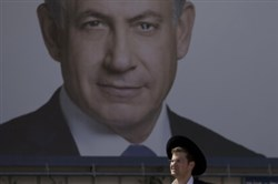 Benjamin Netanyahu appears on a billboard near Tel Aviv.